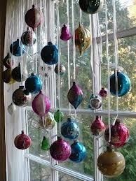 Ornaments hung in the window make for an eye-catching display.