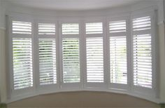 Example of how full height shutters with a mid rail look when installed Bay Window Shutters, White Shutters, Diy Shutters, Interior Shutters, House Blinds, Blinds For Windows, Bay Window Inspiration, 1930s Semi Detached House, Bay Window Treatments