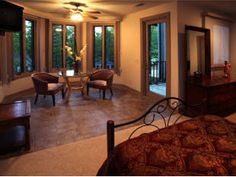 Find this home on Realtor.com  Another guest room with sitting area. All bedrooms open to a deck.