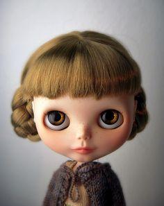 I had one of these Blythe dolls,  when I was little you can pull a string at the back and change the colour of their eyes very cool and great hair too!