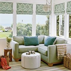 A green hand-blocked fabric dresses the windows in this master bedroom sitting area. Coastalliving.com