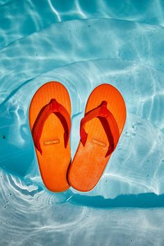 Orange is the new everything! Colorful flip flops are just what you need for a poolside summer. Rubber Sandals, Mens Flip Flops, Floating In Water, Orange Is The New, Your Shoes, Dune, Leather Sandals, Colorful, Summer