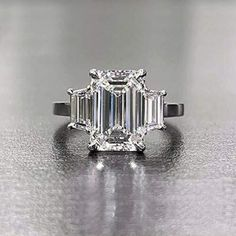 3.10 Tcw Emerald Cut with Trapezoid side 3 Stone Diamond Engagement Ring