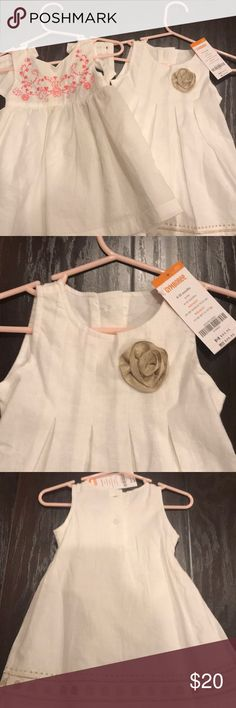 2 Gymboree dresses 6 to 12 months Gold flower dress brand new with bloomers.  The white/ cream  and coral back cut out worn once Dresses