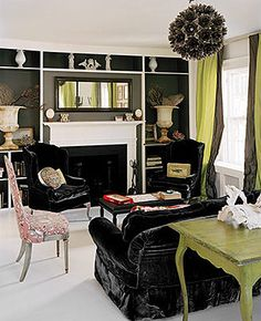 Easy addition of fake bookcases around the Fireplace along with accent paint. Love the velvet wingbacks.
