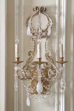 Reine Sconce by @ebanistacollect. 3-light sconce. Hand-forged wrought iron frame in antiqued gold finish. Clear crystal beading and hand carved and polished semi-precious rock crystal prisms. Discover more at http://www.ebanista.com.