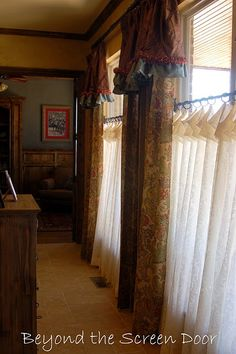 Such gorgeous window treatments