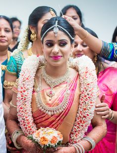 Beautiful South Indian Bride in a Pink Silk Bridal Saree with Diamond Jewelry Indian Wedding Flowers, Flower Garland Wedding, Indian Wedding Decorations, Wedding Garlands, Bridal Sarees South Indian, Indian Bridal Wear, South Indian Bride, Kerala Bride, Hindu Bride