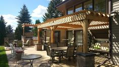 Paver patio and outdoor kitchen with natural wood pergolas Wood Pergola, Natural Wood, Outdoor Structures, Patio, Kitchen, Nature, Cuisine, Wooden Pergola, Yard