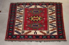 """A favorite small """"Kazak"""" Russian rug. Can be hung on the wall just like a painting. Russians use these to decorate their homes, most of them are handmade using  lambs wool among others."""