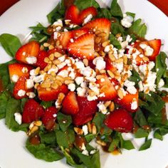 Strawberry Spinach Salad with Goat Cheese Start by toasting 1/4 C pine nuts lightly in a skillet On the stove (approx 5 mins). Prepare dressing in a shaker or by whisking 1/4 C balsamic vinegar, 1/2 tsp salt, 1 tsp sugar, 2 tsp Dijon mustard and 1/2 C olive oil in a medium bowl.  When ready to serve, Toss 12oz pkg. spinach leaves and dressing in a large bowl. Add 1/4 C toasted pine nuts, 1+1/2 C sliced strawberries. Toss gently, while adding in most of a 4oz pkg. of crumbled goat cheese…