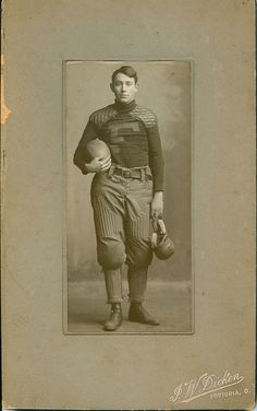 Great antique photo of man dressed in football uniform.