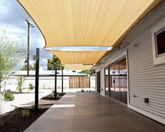 Wood Decking With Large Sail Shades