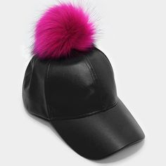 "New celebrity favorite vegan leather fur pom pom baseball hat in black with a hot pink pom pom! 11"" Rim / 7"" Inner Diameter - Adjustable / 7.5"" Height. 100% polyester."