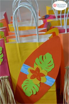 Surfboard favor bags at a luau birthday party! See more party planning ideas at CatchMyParty.com!