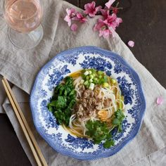 Spicy Noodle Bowls with Sausage and Greens, paired with rose wine.