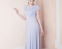 The full length Moon dress features a timeless skirt silhouette with sculpting pleats at the waist and shoulders of the fitted bodice. The back of the dress has a draped cowl and delicate waist enhancing pleats. Our dresses epitomise grace and elegance and have all been skillfully designed to give the most flattering fit and appearance. Our luxurious jersey fabric is handled in such a way that it provides structure and shaping whilst also stretching softly to ensure the very best...