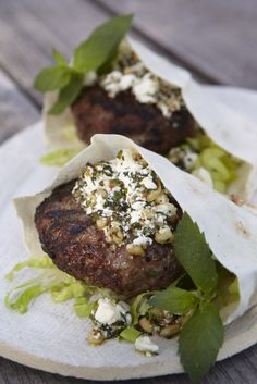 Lamb Burger with Feta Pesto by sweetpaul: Made with feta, toasted pine nuts, mint, red chili flakes, ground lamb,  cumin, coriander, and served with pitas and lettuce! #Lamb_Burger #sweetpaul