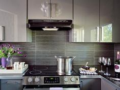Explore your options in beautiful kitchen backsplashes in materials like ceramic tile, stainless steel, glass and slate.