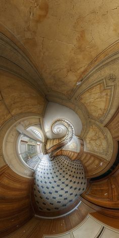 The famous stairs of the Galerie Vivienne by Vincent Montibus, via Flickr   /The fisheye lens gives an Alice in Wonderland feeling too this scene