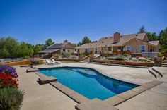 This angle of the pool gives more perspective to the actual pool itself. It's perfect for swimming laps or summer pool parties. A countryside backyard oasis with the right size inground pool great for all families.