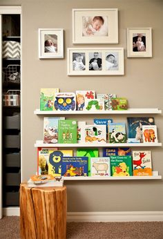 Library Wall for Nursery. Use IKEA Ribba picture ledges to display children's books in Hallie's reading corner. Create cute collage about book display.