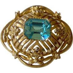 Pretty Gold-tone and Blue brooch. Vintage Jewelry Under $25  www.rubylane.com @Ruby Lane