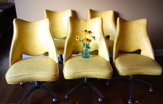Throwback Dining Chairs! Yellow Vinyl, Padded, Swivel and Rolling...say hello to 1970. (Mid Century Modern)