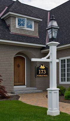Lamp post with sign. Love the house too. But if I had this lamp post I'd have the lantern the same color as the pole.