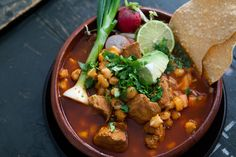 Traditional Mexican posole (pozole), a broth rich soup made with pork, red chiles, and lots of add-ins like shredded cabbage, radishes, cilantro, lime, and avocado. ~ SimplyRecipes.com