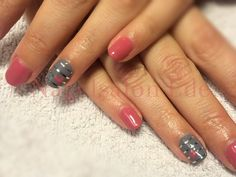 Nailart with silver striping tape and a heart.