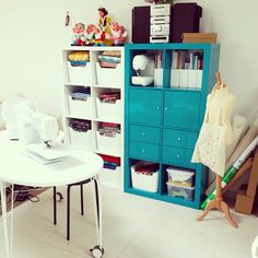 A bright and colorful sewing room with lots of storage spaces for fabrics and notions.