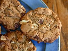 Makes about 2 1/2 dozen cookies    1 cup almond butter    1/2 cup light or dark brown sugar    1/2 cup granulated sugar    1 large egg    1 teaspoon baking soda    2 tablespoons maple syrup    1 teaspoon vanilla    Pinch of salt    1/2 cup slivered almonds    1/2 cup semisweet chocolate chips    Preheat oven to 350 degrees