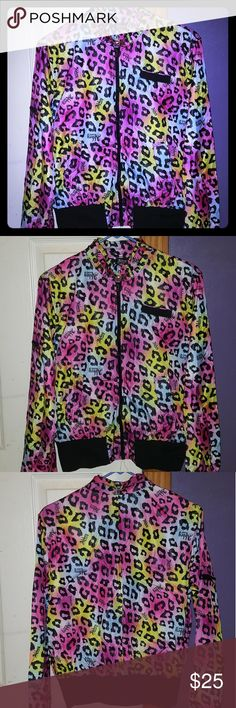 Cheetah Print Windbreaker Jacket Brand New/Never Worn w/out Tags  Woman's Multi Colored Cheetah Print Windbreaker Jacket  Brand: Abbey Dawn by Avril Lavigne Size: Large Abbey Dawn Jackets & Coats
