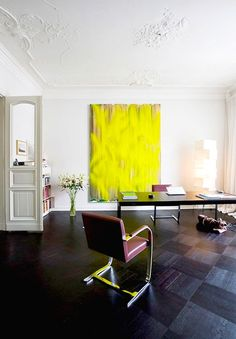 Statement-making yellow painting in home office