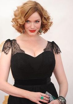 """Christina Hendricks (""""Mad Men"""") continued to support """"Project Runway"""" winner and Annapolis native Christian Siriano. She wore a black lace gown from the designer."""