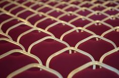 Inspired by Pantone's 2015 Color of the Year: Marsala: Close-up of red chairs in an empty room by Diana Matei Zaharia