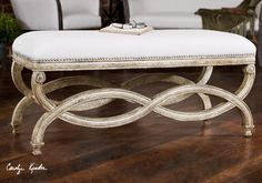 UTTERMOST/Karline Bench:Hand carved, white mahogany frame with antiqued almond finish. Covering is natural linen and cotton with Teflon(R) fabric protector accented with brass nails.  Designer: Carolyn Kinder  Dimensions: 42 W X 20 H X 18 D (in) (in)  Weight (lbs): 30  Ship Via UPS: No  UPC Number: 792977230756