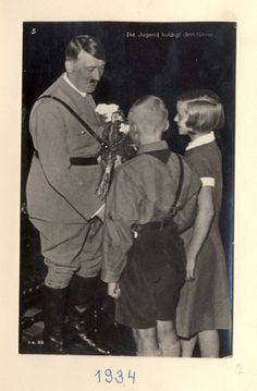 Germany, 1934, Adolf Hitler with children. - An album of photographs from the life of Adolf Hitler.