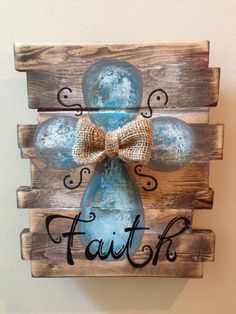 Beautiful wall decor made from repurposed pallet wood then hand painted.