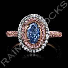 Blue Diamond surrounded by a halo of Pink Diamonds and another halo of colorless diamonds. EXQUISITE! #love #fashion #wow #idea #gifts #anniversary #diamonds #diamond #diamondring #diamondrings #anniversary #anniversarygift #jewelry #diamond jewelry #pinkdiamonds #bride #weddingday #weddingrings #engagement #engagementring #losangeles #calabasas #malibubeach #beverlyhills #bellaire #santabarbaracounty