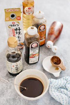 Homemade yakisoba sauce in a small Japanese pottery bowl with ingredients bottles around.