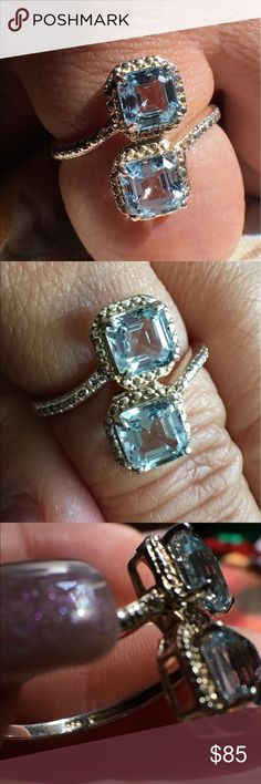 Sterling Silver Aqua stone ring Marked 925 inside band and STS designers mark. May contain diamond chips inner stones nearest middle on each side nearest blue stones. Jewelry Rings