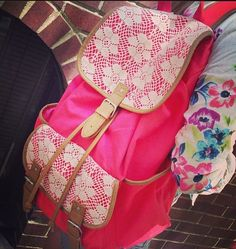 Aero pink and lace trimmed backpack these things are so cute I really need to get one!!