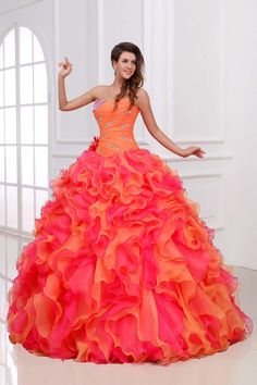 This dress reminds me of pink & orange Starburst!  Candyland Theme Quinceanera | Quinceanera Themes | My Perfect Quince