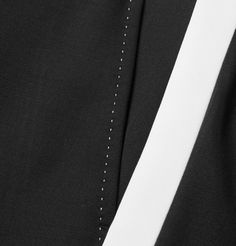 Reminiscent of classic tuxedo styles, these black trousers by <a href='http://www.mrporter.com/mens/Designers/Dolce_and_Gabbana'>Dolce & Gabbana</a> have been tailored in Italy from black and white wool-twill. They're designed in a slim profile and have considered tailoring details such as waist tabs and discreet concealed fastenings. The internal satin trim is printed with the brand's signature crown - a symbol of quality, lo...