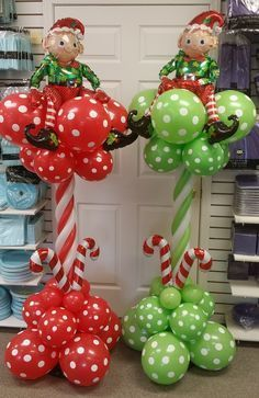 Cute balloon columns in green and red. With candy canes and helpful little elves on top.