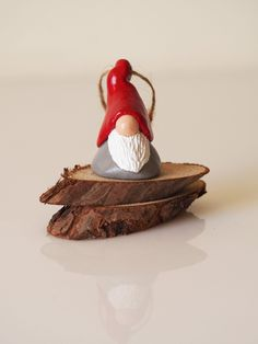 Christmas Gnome ornament - Nordic gnome figurine - Swedish Tomte - Christmas elf - Nordic Christmas - Clay gnome decoration - Elf decoration by paintmydream on Etsy https://www.etsy.com/listing/257349627/christmas-gnome-ornament-nordic-gnome