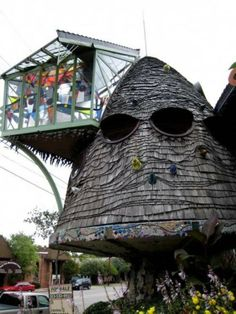 The Mushroom House, Cincinnati, Ohio. Very strange! Looks like the house is wearing shades!