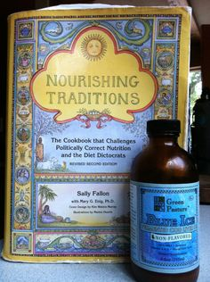 Nourishing Traditions--love this book. I take butter oil/fermented cod liver oil every day and I can really tell a difference.